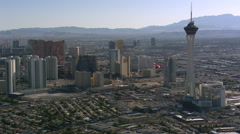 Stock Video Footage of Close flight past the Las Vegas Stratosphere looking south. Shot in 2008.