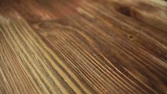 Paint brush painting  wooden table with wood stain - stock footage