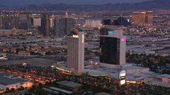 Orbiting Flamingo Avenue casinos, looking toward north Las Vegas in evening - stock footage