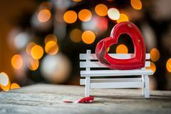 Valentine broken heart on a wooden bench Stock Photos