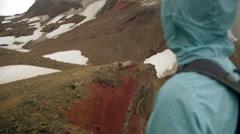 Hiker appreciates the view - stock footage