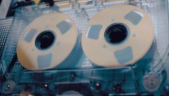 The cassette is played in the tape recorder and rewind the reel of the tape - stock footage