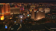 Night flight above casinos along The Strip with wide view of glittering Las - stock footage