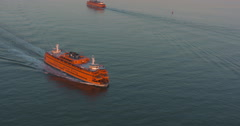 Stunning sunset aerial shot of the Staten Island Ferry Stock Footage