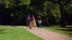 A family strolling through a park - stock footage