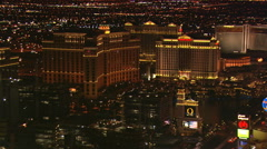 Night flight past the Bellagio and its neighbors on Las Vegas Boulevard. Shot in - stock footage