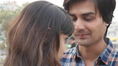 Couple talking smiling and in love in public park Stock Footage