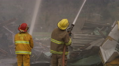 Firefighters using high pressure hoses Stock Footage