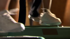 Close-up feet of women participating in a step-aerobics class Stock Footage