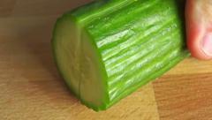 Macro shot of cutting cucumber lengthwise Stock Footage