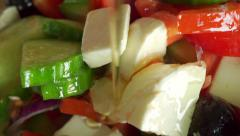 Macro video: pouring olive oil on Greek salad. Part of the set - stock footage