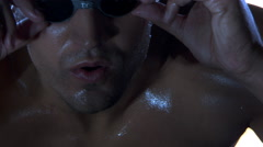 Close-up face of a lap swimmer in goggles Stock Footage