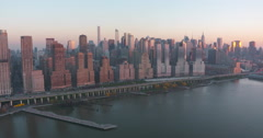 Hudson River Aerial view of Manhattan Skyline at Sunset from Helicopter Stock Footage