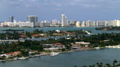 Flight following MacArthur Causeway with Miami skyline in distance. Shot in Stock Footage