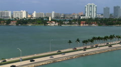 Flying over Star Island with Miami beyond. Shot in 2007. - stock footage