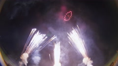Fireworks with multiple explosions from below frame Stock Footage
