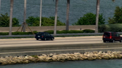 Flight paralleling MacArthur Causeway and Miami's South Beach skyline. Shot in Stock Footage