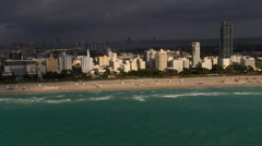 Flight along Miami Beach under stormy skies. Shot in 2007. Stock Footage