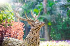 replica of the deer made from tree roots - stock photo