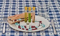 Alimentation with pills food - stock photo