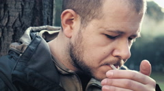 Man in a park smoking weed, joint Stock Footage