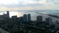 Flight toward Biscayne Bay over cloudy Miami. Shot in 2007. Stock Footage