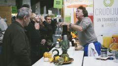 Fresh juice masterclass at food fair - stock footage