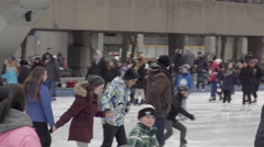 People skating at outdoor rink in front of city hall in Toronto. 4K UHD. Stock Footage