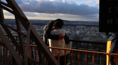 Cute couple looking at the city Paris Stock Footage