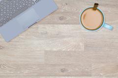 Hero Header image of tidy desktop with mug of coffee - stock photo