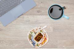 Hero Header image of tidy desktop with snack - stock photo
