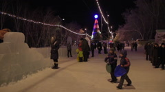 Children ride a roller coaster Christmas tree lights Stock Footage