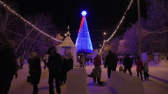 People walk winter LED Christmas tree Stock Footage