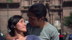 Close-up of young Peruvian couple embracing near Plaza de Armas, Cusco Stock Footage