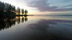 Sunset over the Beloyarsk reservoir. Beloyarsk, Sverdlovsk region, Russia Stock Footage