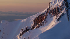 Flight past Oregon's Mount Hood in morning light Stock Footage