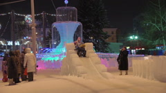 Christmas Russian Children slide down the icy hill Stock Footage