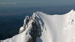 Close flight past peak of Oregon's Mt. Jefferson Stock Footage