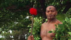 Male Fijian ceremonial dancer posing for portrait - stock footage