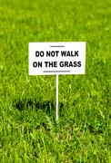 "Notice board on the lawn with text ""Do not walk on the grass"" Stock Photos"