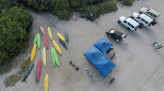 Kayaks and Jeeps 4x4 zoom out Stock Footage