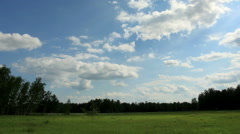 Movement of clouds over the meadow. Kargat, Novosibirsk Region, Russia, Full HD Stock Footage
