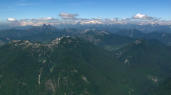 Slow flight along forested ridge in Canadian Cascades, British Columbia - stock footage