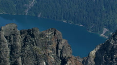 Close flight over ridge to view of lake in Canadian Cascades, British Columbia - stock footage