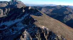 Low flight along granite ridge in Colorado Rockies Stock Footage