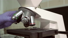 Microscope blood testing and analysis at modern medical laboratory - stock footage