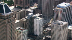 Flight with steep look down onto Baltimore skyscrapers. Shot in 2003. Stock Footage