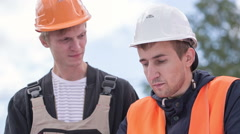 Engineering work together with workers Stock Footage
