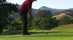 Frustrated golfer swinging and then throwing club down and stalking off Stock Footage