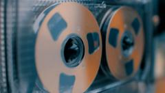 Stock Video Footage of Rotation golden reel of vintage audio cassette in different color correction